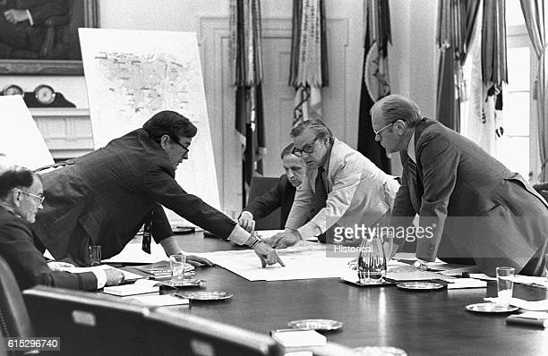CIA director George Bush discusses the evacuation of Americans from Beirut with President Gerald Ford and members of the National Security Council