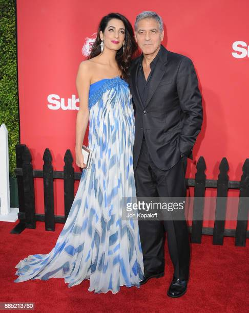 Director George Clooney and wife Amal Clooney arrive at the Los Angeles Premiere 'Suburbicon' at Regency Village Theatre on October 22 2017 in...