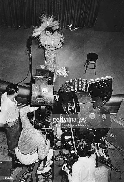 Director George Cukor and crew on the set of Paramount's 1939 production, the romantic costume drama, 'Zaza' . In front of the cameras is film star...