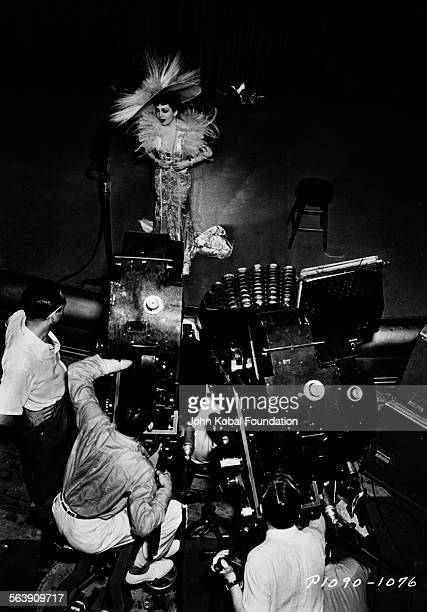 Director George Cukor behind the camera filming actress Claudette Colbert on stage on the set of the film 'Zaza' for Paramount Pictures 1939