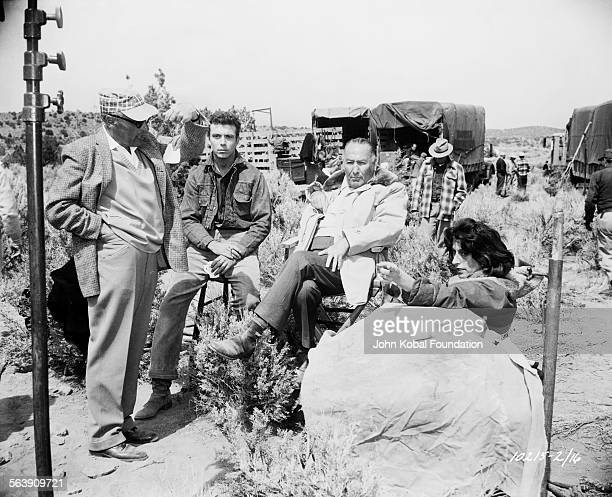 Director George Cukor in discussion with his crew on the set of the film 'Wild is the Wind' for Paramount Pictures 1957