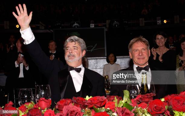 Director George Lucas and actor Harrison Ford pose at the dinner during the 33rd AFI Life Achievement Award tribute to George Lucas at the Kodak...