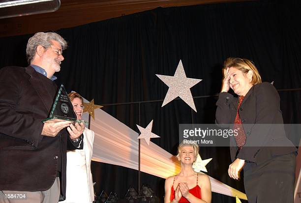 Director George Lucas presents the Screen Actors Guild Harold Russell Award to actress Carrie Fisher at the 20th Annual Media Access Awards at the...