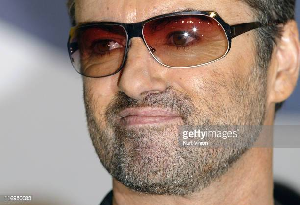 Director George Michael arrives to the press conference for his film George Michael A Different Story
