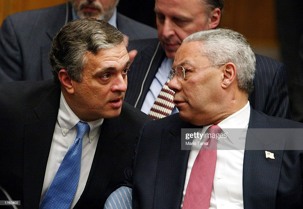 Director George Tenet (L) and U.S. Secretary of State Colin Powell speak following Powell's address to the UN Security Council February 5, 2003 in New York City. Powell made a presentation attempting to convince the world that Iraq is deliberately hiding weapons of mass destruction.