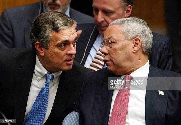 Director George Tenet and U.S. Secretary of State Colin Powell speak following Powell's address to the UN Security Council February 5, 2003 in New...