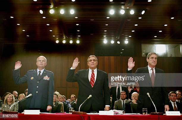 Director George Tenet Lt Gen Michael Hayden the Director of the National Security Agency and FBI Director Robert Mueller are sworn in 17 October 2002...
