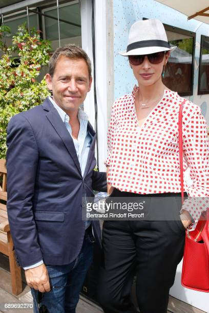 Director Geraldine Maillet and her husband journalist Daniel Riolo attend the 2017 French Tennis Open Day Two at Roland Garros on May 29 2017 in...
