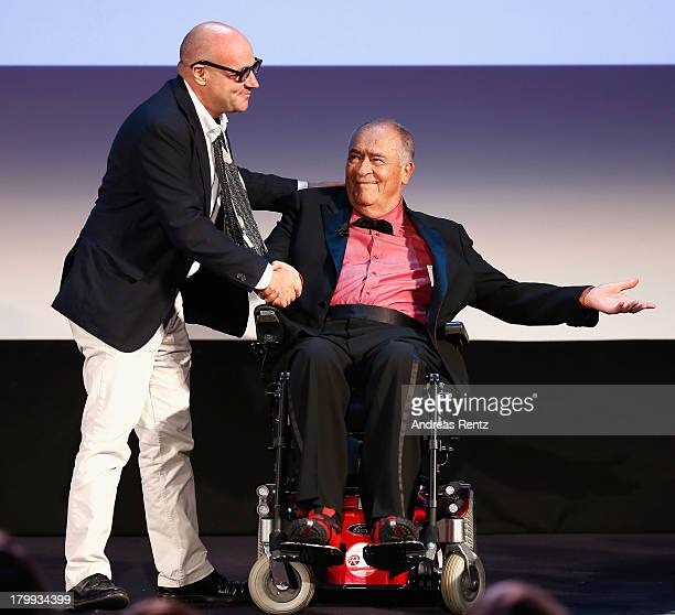 Director Gianfranco Rosi and Jury Member Bernardo Bertolucci on stage during the Closing Ceremony of the 70th Venice International Film Festival at...