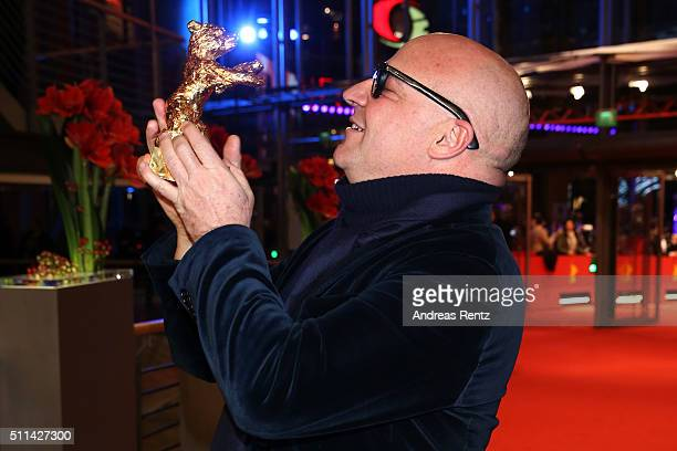 Director Gianfranco Rosi winner of the Golden Bear for Best Film for his movie 'Fuocoammare' poses with his award after the closing ceremony of the...