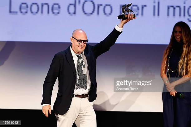 Director Gianfranco Rosi wins the Golden Lion for Best Film for his movie 'Sacro Gra' as he attends the Closing Ceremony during the 70th Venice...