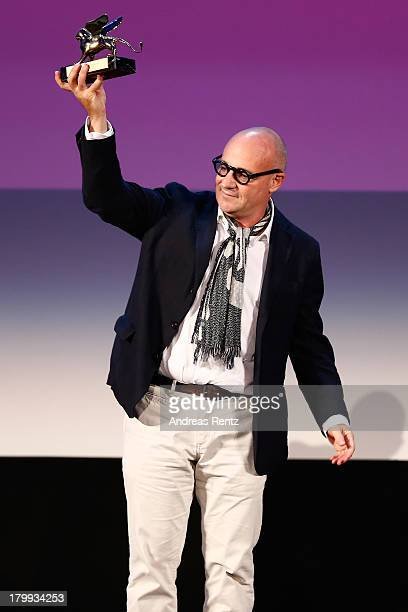 Director Gianfranco Rosi wins the Golden Lion for Best Film for his movie 'Sacro Gra' during the Closing Ceremony of the 70th Venice International...