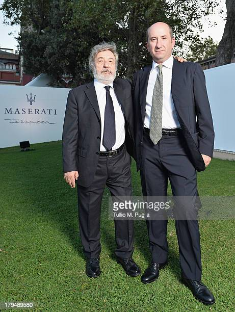 Director Gianni Amelio and actor Antonio Albanese attend the 70th Venice International Film Festival at Terrazza Maserati on September 4, 2013 in...