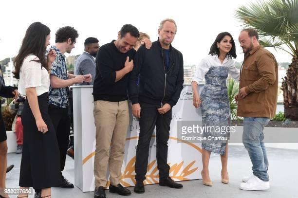 Director Gilles Lellouche and actor Benoit Poelvoorde poses with cast members Noee Abita Felix Moati Thamilchelvan Balasingham Leila Bekhti and Alban...