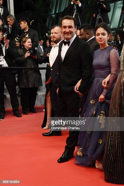 Director Gilles Lellouche and actress Noee Abita depart the screening of 'Sink Or Swim ' during the 71st annual Cannes Film Festival at Palais des...