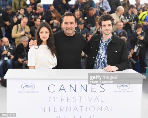 Director Gilles Lellouche poses with actress Noee Abita and actor Felix Moati at the photocall for Sink Or Swim during the 71st annual Cannes Film...