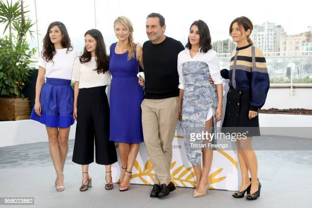 Director Gilles Lellouche poses with actresses Melanie Doutey Noee Abita Virginie Efira Leila Bekhti and Marina Fois at the photocall for Sink Or...