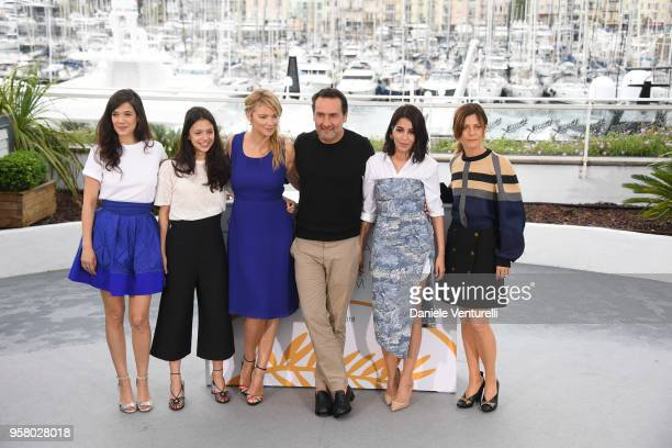 Director Gilles Lellouche poses with actresses Melanie Doutey Noee Abita Virginie Efira Leila Bekhti and Marina Fois attend the photocall for the...