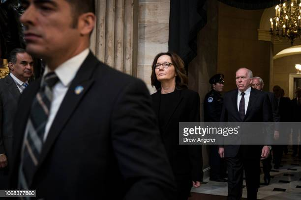 Director Gina Haspel and former CIA Director John Brennan pay their arrive to pay their respects at the casket of the late former President George HW...
