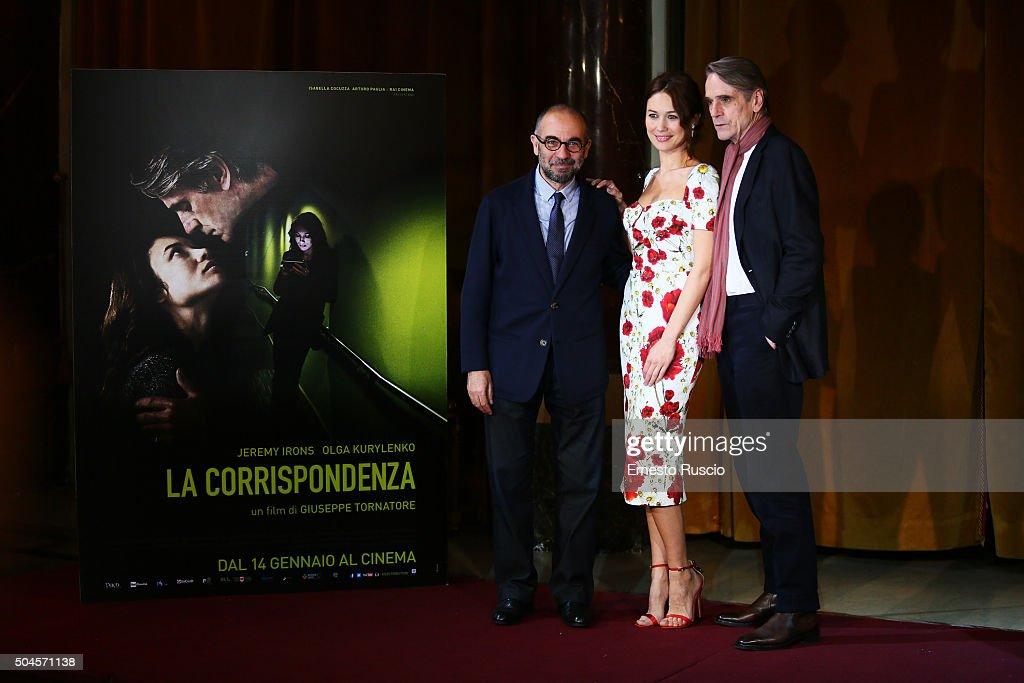 Director Giuseppe Tornatore, Olga Kurylenko and Jeremy Irons attend the 'La Corrispondenza' photocall at Hotel St Regis on January 11, 2016 in Rome, Italy.