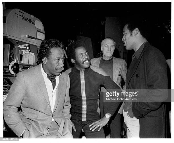 Director Gordon Parks with actor Richard Roundtree and OJ Simpson behind the set of the movie 'Shaft's Big Score' circa 1972