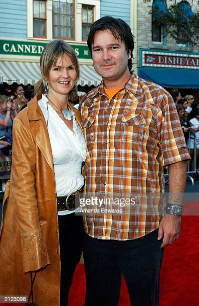 Director Gore Verbinski and his wife Clayton arrive at the World Premiere of 'Pirates of the Caribbean The Curse of the Black Pearl' on June 28 2003...