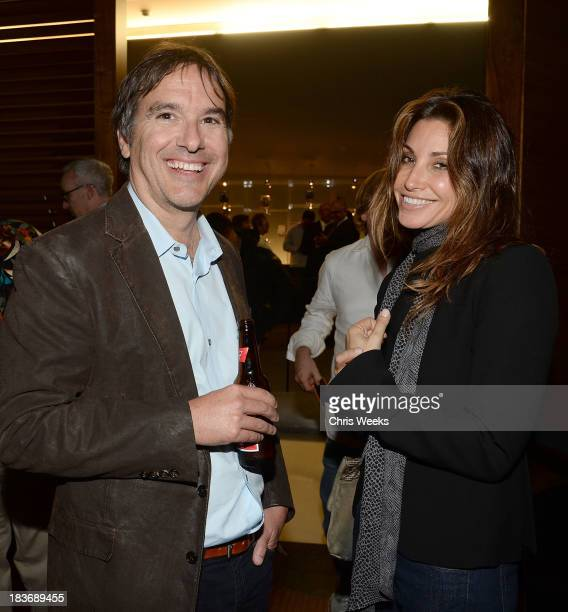 Director Greg Camalier and actress Gina Gerson attend a special screening of Muscle Shoals at the Landmark Theater on October 8 2013 in Los Angeles...