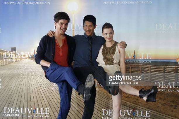 US director Gregg Araki US actor Thomas Dekker and French actress Roxane Mesquida pose during the photocall of their movie 'Kaboom' presented out of...