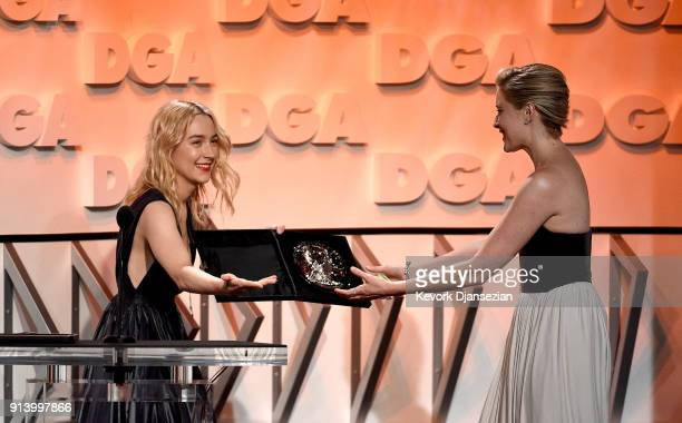 Director Greta Gerwig accepts the Nomination Medallion for Outstanding Directorial Achievement in Feature Film for 'Lady Bird' from actor Saoirse...