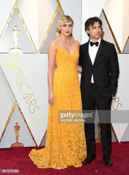 Director Greta Gerwig and Noah Baumbach arrive for the 90th Annual Academy Awards on March 4 in Hollywood California / AFP PHOTO / VALERIE MACON