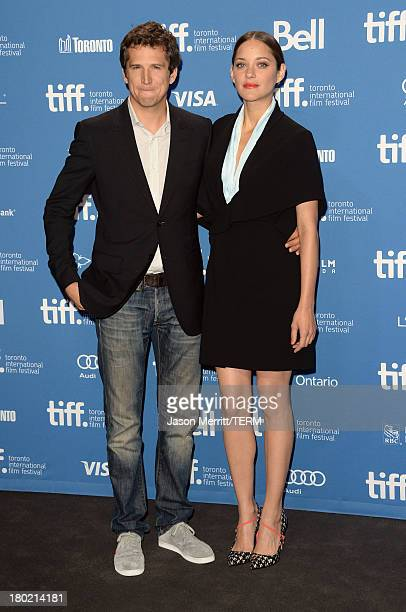 Director Guillaume Canet and actress Marion Cotillard attend 'Blood Ties' Press Conference during the 2013 Toronto International Film Festival at...