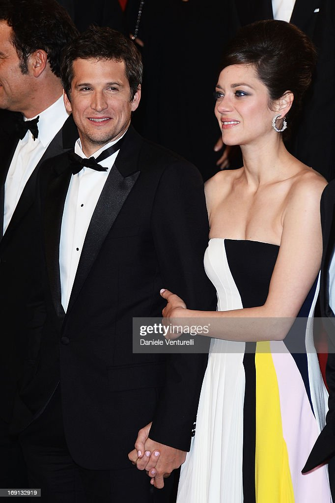 Director Guillaume Canet and actress Marion Cotillard leave the Premiere of 'Blood Ties' during the 66th Annual Cannes Film Festival at the Palais des Festivals on May 20, 2013 in Cannes, France.