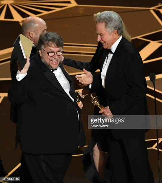 Director Guillermo del Toro accepts Best Picture for 'The Shape of Water' from actor Warren Beatty onstage during the 90th Annual Academy Awards at...