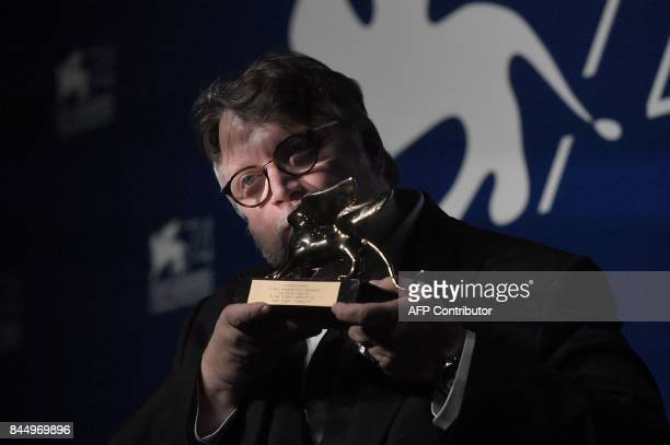 Director Guillermo Del Toro poses during a photocall after he receives the Golden Lion for Best Film with the movie 'The Shape of Water' during the...