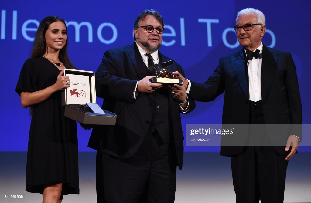 Director Guillermo del Toro (C) receives the Golden Lion for Best Film Award for 'The Shape Of Water' from President of the festival Paolo Baratta (R) and a Jaeger-LeCoultre Unique engraved Reverso watch during the Award Ceremony of the 74th Venice International Film Festival at Sala Grande on September 9, 2017 in Venice, Italy.