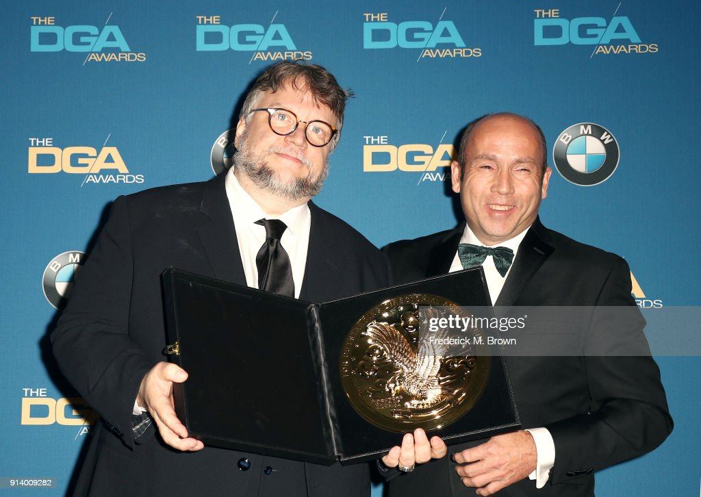 Director Guillermo del Toro, winner of the award for Outstanding Directorial Achievement in Feature Film for 'The Shape of Water', and producer J. Miles Dale pose in the press room during the 70th Annual Directors Guild Of America Awards at The Beverly Hilton Hotel on February 3, 2018 in Beverly Hills, California.