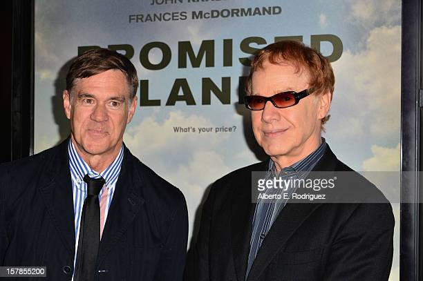 Director Gus Van Sant and composer Danny Elfman arrive to the premiere of Focus Features' Promised Land at the Directors Guild Of America on December...