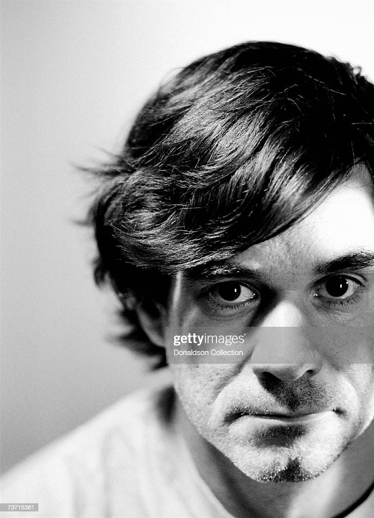 Director Gus Van Sant poses for a photoshoot held in his hotel room in 1991 in San Francisco, California.