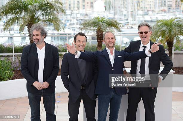 Director Gustave de Kervern actor Albert Dupontel actor Benoit Poelvoorde and director Benoit Delepine pose at the 'Le Grand Soir' Photocall during...