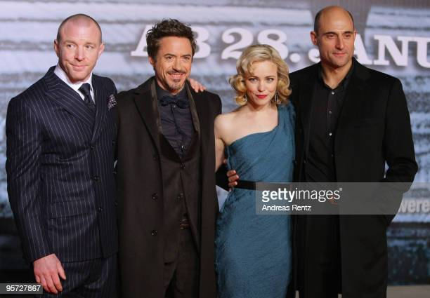 Director Guy Ritchie actress Rachel McAdams actor Robert Downey Jr and actor Mark Strong attend the 'Sherlock Holmes' German Premiere at CineStar on...