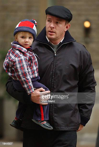 Director Guy Ritchie and his son Rocco leave their midtown apartment April 22 2003 in New York City