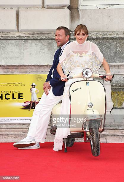 Director Guy Ritchie and Jacqui Ainsley attend the people's premiere of 'The Man From UNCLE' during Film4 Summer Screenings at Somerset House on...