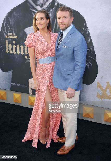 Director Guy Ritchie and Jacqui Ainsley attend world premiere of Warner Bros Pictures' 'King Arthur Legend Of The Sword' at TCL Chinese Theatre on...