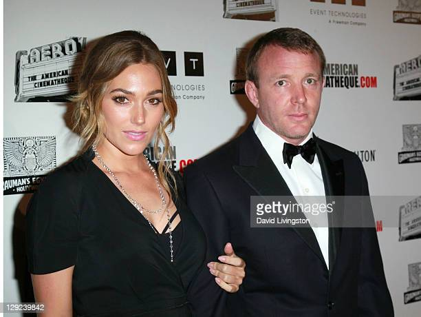 Director Guy Ritchie and model Jacqui Ainsley arrive at The 25th American Cinematheque Award Honoring Robert Downey Jr held at The Beverly Hilton...