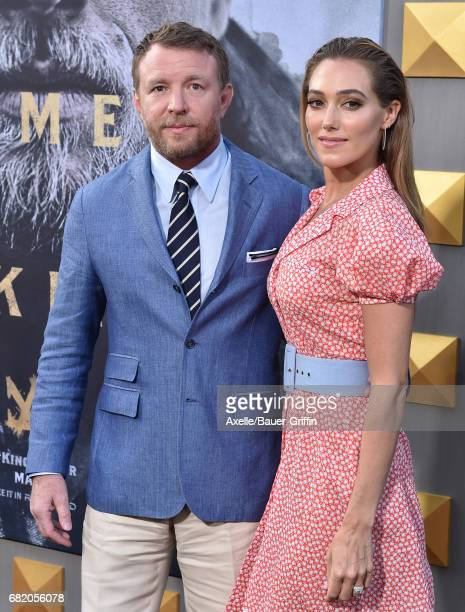 Director Guy Ritchie and model Jacqui Ainsley arrive at the premiere of Warner Bros Pictures' 'King Arthur Legend of the Sword' at TCL Chinese...