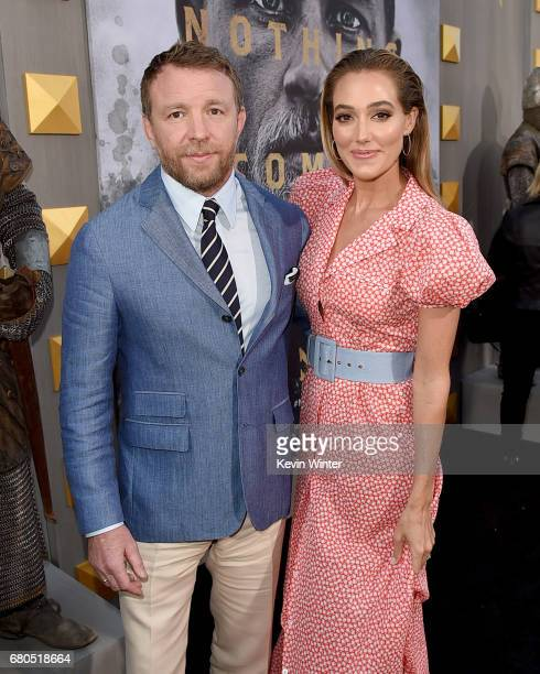 Director Guy Ritchie and model Jacqui Ainsley attend the premiere of Warner Bros Pictures' King Arthur Legend Of The Sword at TCL Chinese Theatre on...