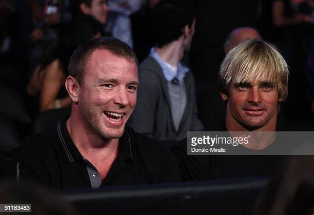 Director Guy Ritchie and Surfer Laird Hamilton attend the WBC World Championship Heavyweight fight between Vitali Klitschko of Ukraine and Chris...