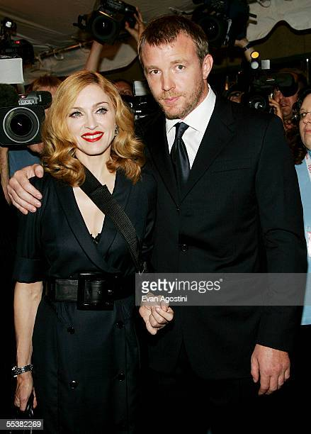 Director Guy Ritchie and wife singer Madonna attend theToronto International Film Festival gala premiere of Revolver at Roy Thomson Hall September 11...