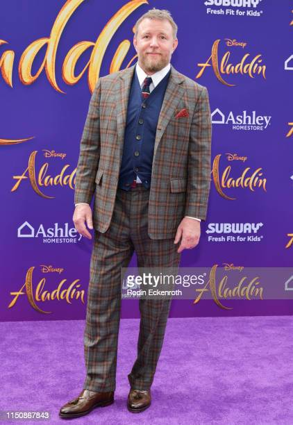 Director Guy Ritchie attends the premiere of Disney's Aladdin on May 21 2019 in Los Angeles California