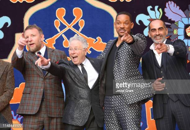 """Director Guy Ritchie, Composer Alan Menken, Will Smith and Navid Negahban attend the World Premiere of Disney's """"Aladdin"""" at the El Capitan Theater..."""